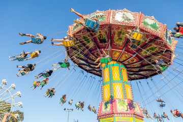 Tradional fairground ride, blue skies, summer fair