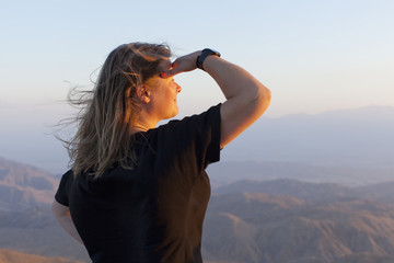 USA, California, Joshua Tree National Park, Female tourist looking at view at sunset