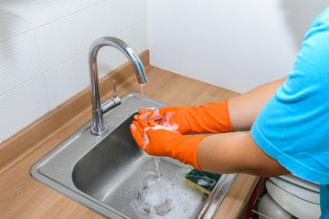 Cleaning Hands wearing gloves. Washing hands