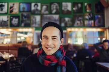 Sweden, Stockholm, Sodermalm, Smiling man at pub