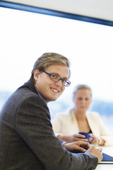 Sweden, Business people sitting at table in office