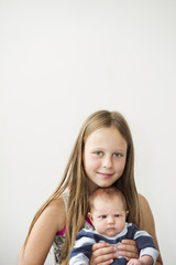 Sweden, Portrait of girl with newborn sister (0-1 months)