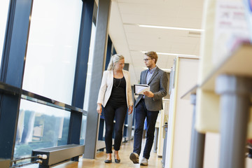Sweden, Two business people having discussion while walking