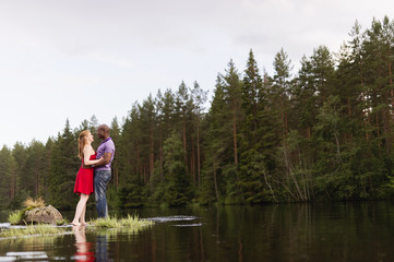 Sweden, Vastmanland, Bergslagen, Svartalven, Mid adult couple embracing in river