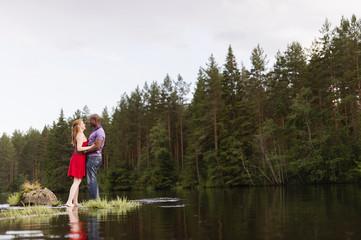 Sweden, Vastmanland, Bergslagen, Svartalven, Mid adult couple embracing in river