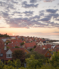 Denmark, Bornholm, Gudhjem, Townscape with Baltic sea in background