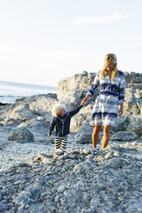 Sweden, Gotland, Faro, Mother and son (2-3) walking on rocky coast