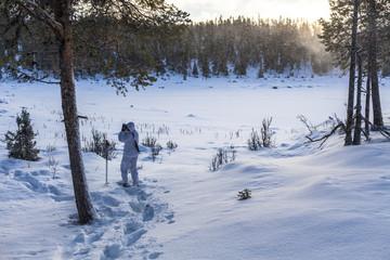 Sweden, Vasterbotten, Tarnaby, Goose hunter (16-17) in winter forest