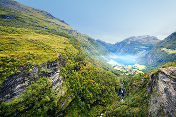 Norway, More og Romsdal, Sunnmore, Geiranger, View along wooded canyon with misty lake