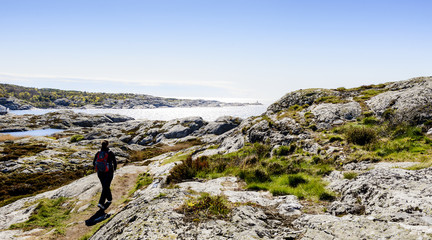 Sweden, West Coast, Bohuslan, Marstrand, Tourist walking and looking at view