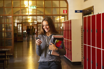 Sweden, Stockholm, Ostermalm, Female student texting on mobile phone