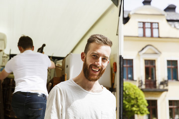 Sweden, Sodermanland, Portrait of young man moving house
