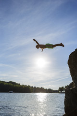 Sweden, Stockholm Archipelago, Teenage boy (16-17) jumping off cliff