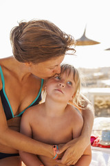 Turkey, Alanya, Mother embracing her daughter (4-5) on beach