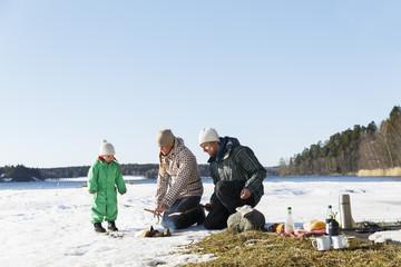Sweden, Sodermanland, Jarna, Family with son (2-3) having picnic