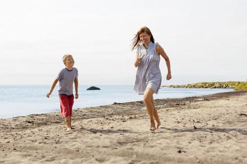 Sweden, Oland, Gronhogen, Mother and son (10-11) on beach