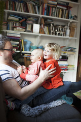 Sweden, Father playing with daughters (6-11 months) ( 2-3)