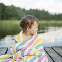 Finland, Uusimaa, Lapinjarvi, Portrait of girl (2-3) wrapped in towel