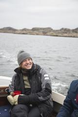 Sweden, Bohuslan, Marstrand, Portrait of mature man on motor boat