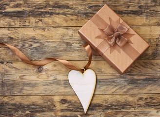 plywood heart on silk ribbon and gift box
