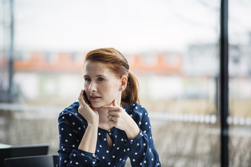 Finland, Helsinki, Portrait of red haired woman