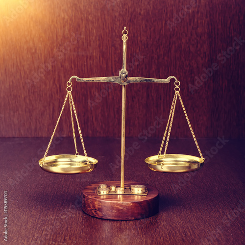 Scales on wooden table law concept for 12 table laws