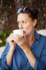 Woman drinking coffee and looking away