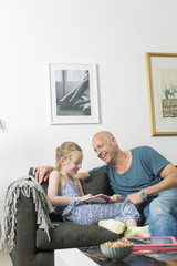 Sweden, Father doing homework with daughter (8-9)