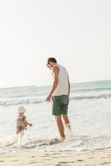 United Arab Emirates, Dubai, Man with son (2-3) on beach