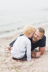 Sweden, Gotland, Ljugarn, Boy (4-5) kissing man on chick