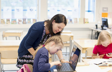 Finland, Girls (8-9) and teacher in classroom
