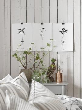 Sweden, Vastergotland, Pictures on wall in bedroom