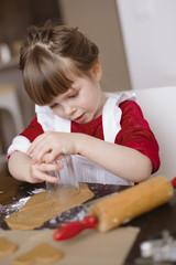 Sweden, Girl (4-5) making gingerbread cookies