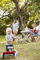 Sweden, Gotland, Havdhem, Family with three children (12-17 months, 2-3) in backyard