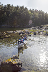 Sweden, West Coast, Bohuslan, Flato, Boys (10-11, 12-13) canoeing on river