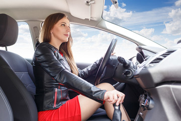 Young woman driving car. Fast delivery background