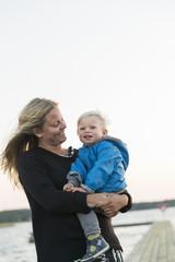 Sweden, Gotland, Farosund, Mother with son (12-17 months) on jetty