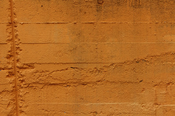 rough cement wall painted orange