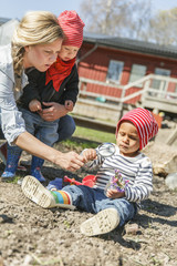 Sweden, Sodermanland, Jarna, Boys (12-17 months) playing with mother