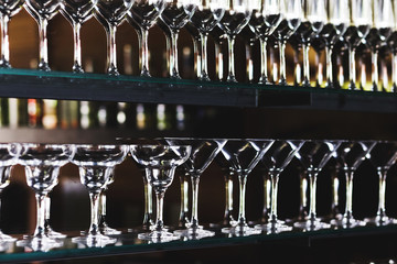 Set of glasses in the bar on a dark background