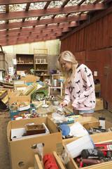 Sweden, Ostergotland, Young woman at flea market