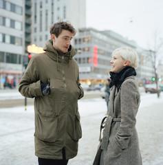 Sweden, Stockholm, Sodermalm, Gotgatan, Young couple talking on sidewalk