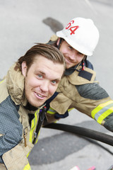 Sweden, Sodermanland, Close up of firefighters working