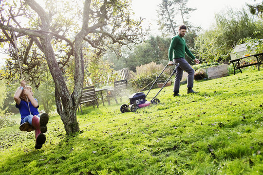 Sweden, Skane, Osterlen, Borrby, Father and son (4-5) in domestic garden