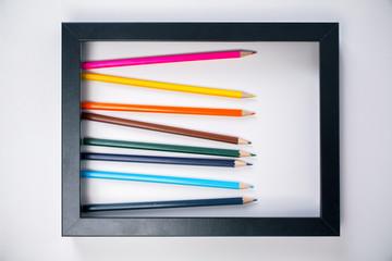 Pencils inside picture frame