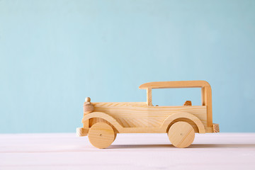 Vintage wooden toy car over wooden table