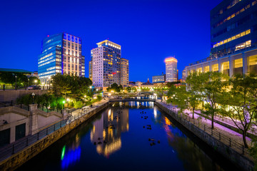 The Providence River and modern buildings at night, in downtown