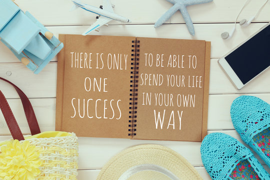 open notebook with motivational saying