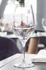 Wine glass on a wooden table in a restaurant