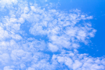 Blue sky background with white clouds. The vast blue sky and clouds sky on sunny day. White fluffy clouds in the blue sky. beautiful clouds and blue sky.